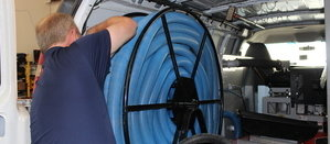 Water Damage Restoration Technician Prepping Suction Hoses