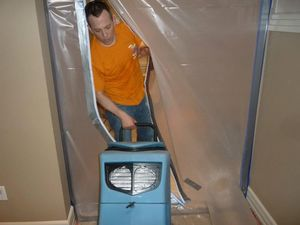 Water Damage East Harlem Technician Using Air Mover Near Vapor Barrier