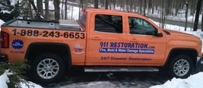 Water and Mold Damage Restoration Truck On Job Site Driveway